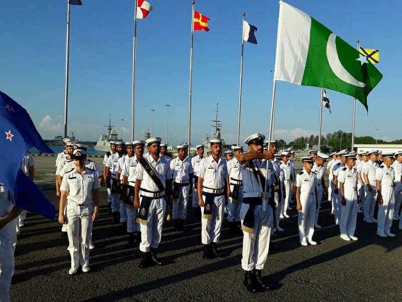 Pakistan Navy and Navel Ranks | Pakistan Navy is the naval warfare and defence branch of the three-tiered Pakistan Military. Here is what you need to know about Pakistan Naval Defense and Naval Ranks The objective of the Naval Force The primary objective of Naval Force is to ensure the defence of the sealines of communications of Pakistan and safeguarding Pakistan's maritime interests by executing national policies through the exercise of military effect, diplomatic and humanitarian activities in support of these objectives. Moreover, the Navy has mobilized its war assets to conduct humanitarian rescue operations at home as well as participating in multinational task forces mandated by the United Nations to prevent seaborne terrorism and privacy off the coasts. Naval Hierarchy of Pakistan The president of Pakistan Dr. Arif Alvi serves as the Navy's Commander-in-Chief while the Chief of Naval Staff Admiral Zafar Mahmood Abbasi oversees the operations and training of the force. Vice Chief of Naval Staff is Muhammad Fayyaz Gilani. Command & Control Structure Leadership in the Navy is provided by the Minister of Defense, leading and controlling the direction of the department of navy from the Naval Secretariat-II at the Ministry of Defense, with the Defense Secretary who is responsible for the bureaucratic affairs of the army's department. The war functions of the Navy is controlled from the single combat headquarters, the Navy NHQ, located in Islamabad at vicinity of the Joint Staff Headquarters and the Army GHQ in Rawalpindi Cantonment in Punjab in Pakistan. The Chief of Naval Staff controls and commands the Navy at all levels of operational command, and is assisted by number of Principal Staff Officers (PSOs) who are commissioned at the three-star rank and two-star rank admirals. The Navy is also the custodian of Pakistan's second strike capability. In addition, the Navy is supported by two paramilitary supporting arms i.e. the Coastguards and the Maritime Security A