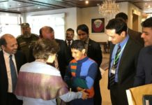 Pakistan reunites an Afghan Child with his family
