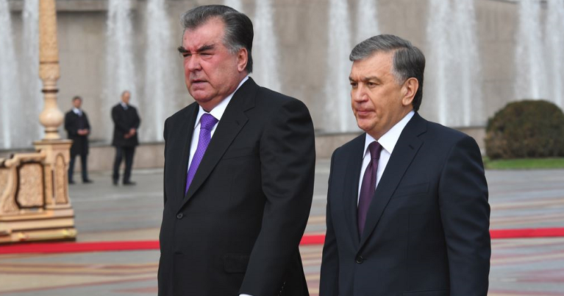 Uzbek President Shavkat Mirziyoev and Tajik President Emomali Rahmon walking together before signing visa-free regime for 30 days between two countries