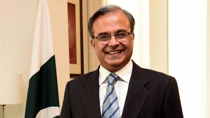 """Asad Majeed Khan - Pakistan's Ambassador to the United States Dr. Asad Majeed Khan has reminded the Donald Trump administration of its promise to act upon its due role to liberalize Kashmiris from the Indian oppression by mediating the negotiation between Pakistan and India. It's been 348 days since the Nazism and Fascism-inspired New Delhi regime wreaked havoc in Indian Occupied Jammu and Kashmir (IOJ&K) by repealing its Special Status and placing unjustified and unlimited restrictions on Kashmir for an indefinite period. As wisdom and ethics demand, the Indian government should have eased the restrictions in IOJ&K in the wake of COVID-19 pandemic, however, it went vice-versa and further tightened the clutches, enhancing Kashmiris' sufferings manifold. In his article """"Kashmir Looks to America for Moral Leadership"""" published on the US weekly magazine Newsweek on July 17, Ambassador Asad Majeed Khan wrote that Indian Occupied Kashmir today is a burden on the conscience of the International Community, and urged it to effectively demand an end to India's egregious human rights violations in IOJ&K. The ambassador noted that the World cannot remain a bystander while systematic attempts are underway to deprive Kashmiris of their identity as well as fundamental rights through stealth and deceit. """"The International Community, particularly the United States, cannot let India get away with its brutal oppression of the Kashmiri people under the cover of the Coronavirus pandemic,"""" he wrote."""