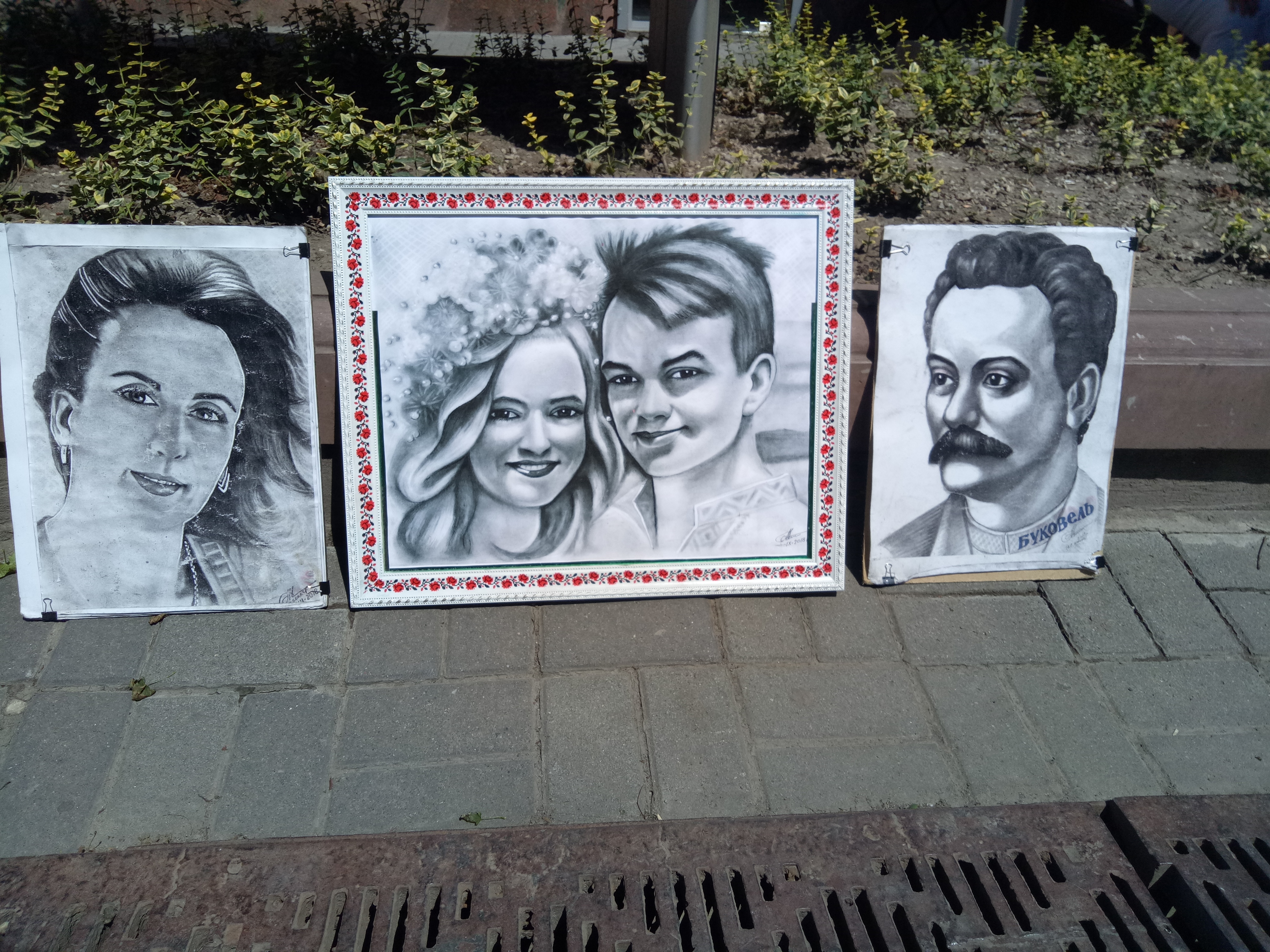 Ivano Frankivsk . In Square (Rynok---Bazaar), your will find several Street Painters. Live sketching of you is not a bad idea indeed.