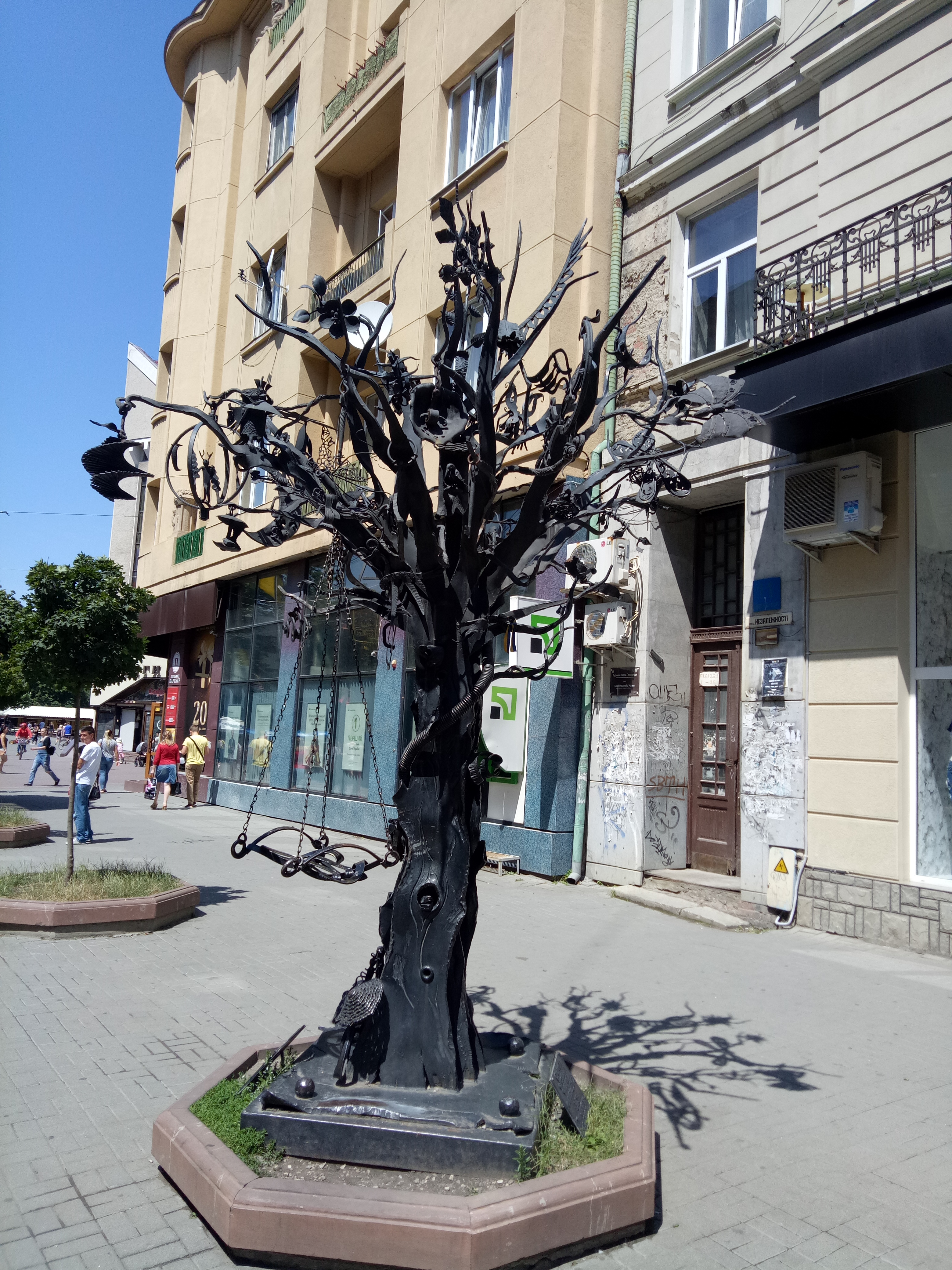 Travel for Cause ---- Ivano-Frankivsk . In Square (Rynok---Bazaar), Steel Tree represents that iron becomes wax when it comes in hands of brave men.
