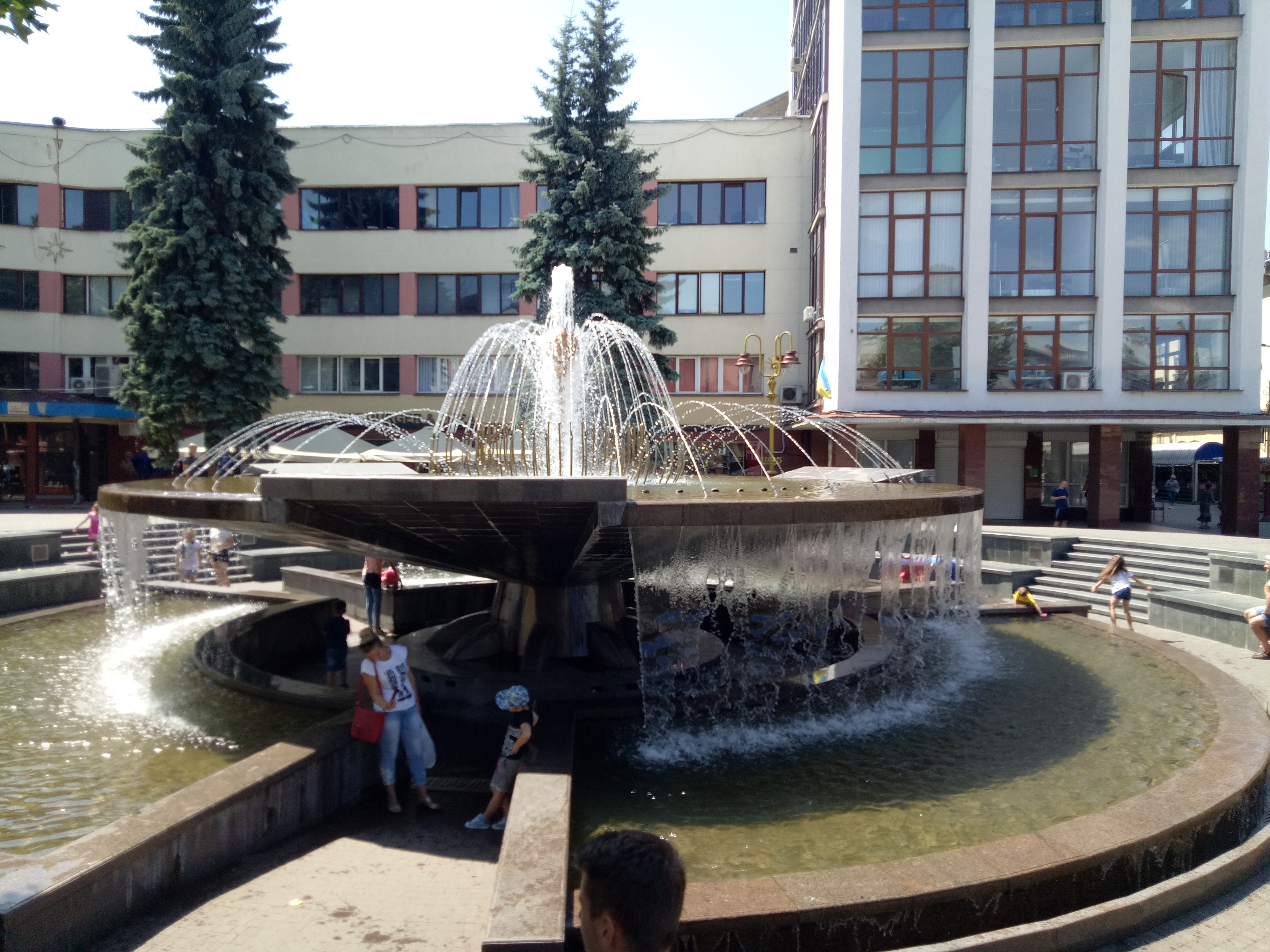 In Square (Rynok---Bazaar), Maydan Vichevy Fountain is full of children with their mothers in summer and gives you a contact with rising nation of Ukrainians. If you descend the steps below the fountain's main 'bowl', you can stand beneath the cascading water without getting wet.