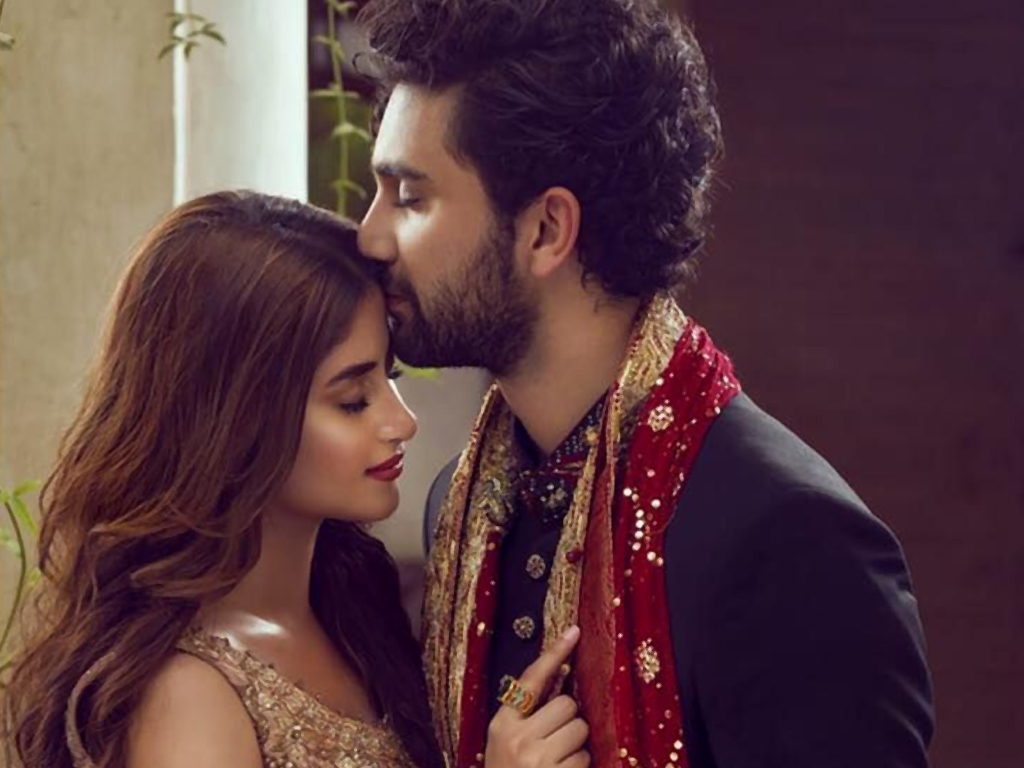 """Sajal Ali and Ahad Raza Mir are reportedly getting married and the wedding festivities have already begun. The news was initially shared by a local entertainment website that uploaded a picture of a cake which had 'Ahad aur Sajal ki dholki' written over it. Tagging Sajal and Ahad on the post, the portal wrote, """"Let the wedding festivities begin."""" Something is definitely cooking as the internet has been flooded with pictures showing a case with the caption """"Sajal Ahad Ki Dholki."""" And that's not the only picture circulating around. Aly Syed, Sajal's brother also posted a picture of himself alongside Adnan Raza Mir and Ahad's mother all decked up for some festive occasion."""