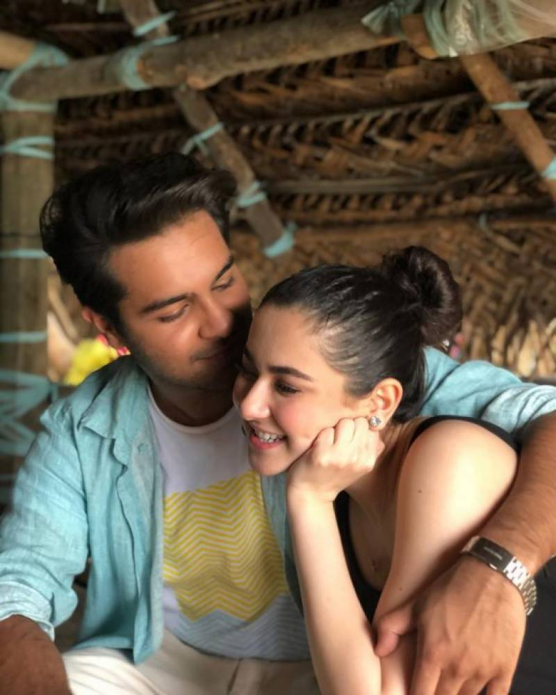 """Hania Amir - Asim Azhar is a Pakistani singer, songwriter, and actor he also appeared in the Coke Studio Season 9 while Hania Amir is a film and television actress, model, and casual singer. They both became popular on social media because of their friendship but recently social media was filled with memes and funny comments over the recent statement by Hania Aamir that she is single. Actually, everyone was very curious about the relationship between Asim Azhar and Hania Amir and though that they were together. Recently Hania Amir publicly spoke regarding her relationship with singer Asim Azhar. During a live session with another singer Aima Baig, Hania clearly and categorically denied the existence of any romantic relationship between Asim Azhar and herself. Answering a fan's question whether she is in a romantic relationship the singer, the actress responded, """"We are friends, we are not together, we are not dating, we are not a couple. But we certainly are best friends."""" She also added that """"Her boyfriend is her work these days,"""" After this statement people started to troll Asim about how he was also friend zoned. This created a lot of hype on social media platforms (Twitter, YouTube, and Facebook) which again created tension between both of them. Recently while Hania celebrated 3 million followers on Instagram and thanked her fans for all the love and support, and in the end, she asked the trolls to back off. She said that """"Asim is a beautiful part of my life and we have seen some insane times together,"""" """"We share a bond beyond anyone's comprehension. We choose to look at and acknowledge love, not hate. That being said, we know Pakistaniyon ka humor acha hai lekin easy. Social media ke troll sipahiyon, bilkul free na ho aur zayada over bhi nahi. Shukriya."""" This created a lot of heat because the troll army always needs something and someone to make fun of so is it better not to provoke them."""