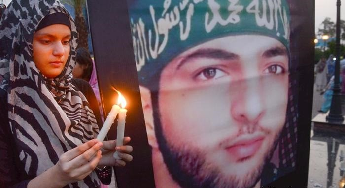 Burhan Wani - The fourth martyrdom anniversary of Kashmiri youth leader Burhan Muzaffar Wani is being observed on Wednesday to pay glowing tribute to the young martyr and reiterate the pledge to continue the struggle for Kashmiris' right to self-determination. The 22-year-old top Hizbul Mujahideen Commander Burhan Wani was martyred along with his two associates on July 8, 2016 in Kokernag area of Indian Occupied Kashmir's Anantnag district. His death triggered massive anti-India and pro-freedom protests across the Indian Occupied Jammu and Kashmir (IOJ&K) and reinvigorated the just struggle for Kashmir's freedom. To mark the fourth martyrdom anniversary of Burhan Wani, a complete shutdown is being observed in IOJ&K today on the call of the veteran Hurriyat leader Syed Ali Gilani and the All Parties Hurriyat Conference (APHC). The objective of the strike is to convey a message to the world community particularly the United Nations that the people of Jammu and Kashmir completely reject the forcible occupation of their motherland by India. As per the APHC Spokesman, July 8 is being observed as Youm--e-Istiqlal [Freedom Day] to reiterate the Kashmiris' resolve that they would continue their struggle for right to self-determination through thick and thin. Meanwhile, to mark the martyrdom anniversary of Burhan Wani, protest demonstrations are being across Azad Kashmir to pay tributes to the martyrs and to draw world attention towards massive human rights violation by Indian troops in Occupied Kashmir. The Kashmir Liberation Cell, Pasban-e-Hurriyat and other social and political organizations have arranged protest rallies and demonstrations in all big and small cities and towns of the state. In Muzaffarabad, main protest gathering is being held at Burhan Muzaffar Wani Chowk. A rally is also being taken out by Pasban-e-Hurriyat in Muzaffarabad.