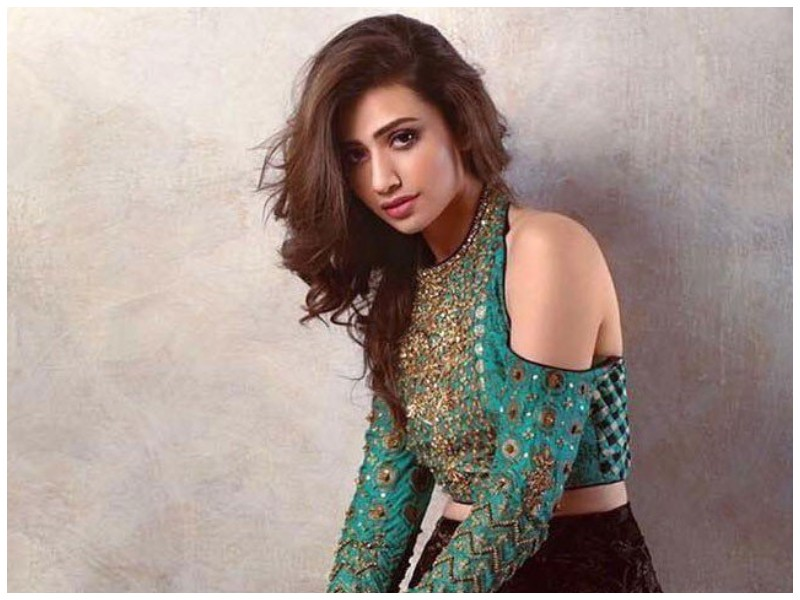 """Now that life is somehow getting back to normal after the Corona tension, the celebrities have resumed their work as well. Mehwish Hayat, Sana Javed, and many others have now started traveling again. Sana, in her recent post, shared a picture of her after travel and it is an eye-opening message for everyone. What Was Sana's Message? Sana Javed was traveling for a work trip when she had to wear a Hazmat Suit and a complete PPE kit for the flight duration. The precautions are absolutely necessary because the pandemic isn't over yet and mingling among people from all around the country or world can still be dangerous. Though we don't know what her destination was, Sana took on a complete gear to ensure that she was safe to and from the 2-hour journey in which interacting with people was necessary. She Salutes Front Line Workers Wearing the PPE kit made her realize that is wasn't easy for the healthcare and the other front-line workers to be wrapped up during the heat throughout the day. This is why she shared this heartfelt message on her Insta post. """"Had to wear this for 2 hours on a flight. Can't imagine how our doctors and all the medical front line workers wear this all day in this heat. """"I salute you for your hardwork, efforts and sacrifice. Let's keep practicing social distancing and follow SOP's. It's not over yet. Let's be cautious and careful for our loved ones and help our health care system so it doesn't collapse."""" In the end, she also shared a prayer for everyone who is affected by the pandemic and wished them health and recovery: """"Sending love and prayers to everyone effected and everyone fighting this pandemic. May Allah help us all AMEEN."""" Her post ended with her crediting the PPE kit to the designer Asim Jofa who when the pandemic started took this upon himself to create the kits and Hazmat suits for the front-line workers who were in a shortage of it. Here is her complete post along with her picture in the complete safety kit on the airport:"""