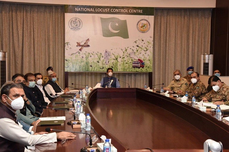 Locust Control - Prime Minister Imran Khan has said that the federal government will undertake every possible effort for locust control since it involves the food security of the Country. While speaking at a briefing on the National Action Plan for Locust Control at the National Locust Control Center in Islamabad on Friday, the prime minister accorded in-principle approval for Phase-II of the National Action Plan for Locust Control. It was also decided that the affected farmers would also be compensated through this package. The prime minister highly appreciated timely and coordinated response of federal and provincial governments including Pakistan army for effectively controlling locust attack and use of indigenously developed equipment. Imran Khan emphasized that a coordinated national response of federal and provincial governments and organisations is required to cope with the expected locust swarm so that crop production is not affected. The prime minister said that the locust attack combined with COVID-19 pandemic was a huge challenge for Pakistan. The prime minister was informed that the National Action Plan for Locust Control Phase-I has been completed.