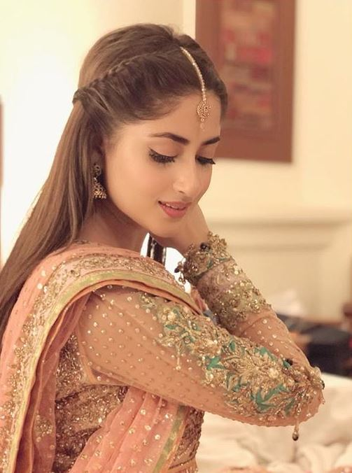 """Sajal Aly is the reigning queen and the undoubted heartthrob of the nation. Even though she has been acting for quite some time, but the past few years have been absolutely lucky for her and the people who like her. She has seamlessly taken over the Television industry of Pakistan and people love her for the work she does. This is why her fans will do anything to make sure she not only notices them but respond to them as well. In one such attempt, a cute team of followers who ran a fan page as well sent Sajal a surprise gift and it is absolutely adorable. Fan Sends Sajal A Long Letter Among the other things that this fan page and its team sent to Sajal, there was a long letter portraying the love for Sajal. The letter was sent by the Instagram account titled @sahadfanatics which has a couple of messages sent by Aly's fans detailing what they want her to know. Among other messages, some includes: """"Your fans are your life."""" """"You will be the prettiest bride ever."""" """"Keep posting your and Ahad's pics."""" Here are the pictures of the letter she posted on her Instagram account: Custom Picture Book One fan went ahead in her quest to show love for Sajal that she made a custom picture book of Sajal's pictures and her pictures with Ahad as well. One of them sent the pictures to her in DM, while the other one sent the book through mail to her. The book consists of some of the best pictures of Aly throughout her acting career and her married life with Ahad as well. Here is what she shared on her Instagram account: Fans' Love For Sajal This goes on to show that people are crazy in love with Sajal Aly and especially adore her couple with Ahad Raza Mir. Not just this, but the Yaqeen Ka Safar actor herself goes out of the way to show that she shares their love and appreciate them for it. If you follow her, you will regularly see her reposting fan collages, stories, videos, and artworks. She not only reposts them but thanks them personally too. Celebrities are what fans make them. Saja"""