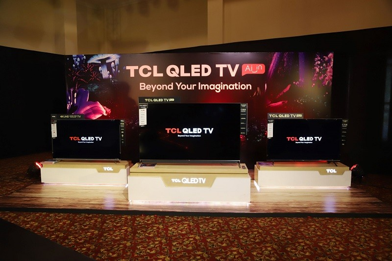 """TCL QLED TVs - TCL, Pakistan's No. 1 LED TV Brand, has launched a new and extended line of 2020 QLED TVs on July 12 to expand its technological horizons. The 2020 new range consists of 3 models – C815, C716, and P715, which are available in a size range varying from 43 to 65 inches. The series was unveiled in an exclusive online launch with the energetic performances by Asim Azhar, Shamoon Ismail, Talha Younus, Talha Anjum, and Raamis on July 12, 2020. The new line of TV is available for purchase on www.tclpakistan.com and across all major retailers nationwide. As mentioned above, the 2020 TV line features an expanded 4K range equipped with stunning Quantum Dot display, Hands-free voice control, built in Onkyo Soundbar with a subwoofer, the latest Android OS and also features a 120 HZ MEMC display. The series has been designed to give the most pristine display and dynamic sound quality available today. Also, the Hands-free voice control lets you control your TV without being dependent on the remote control. Majid Khan Niazi, Marketing Manager of TCL said, """"We have introduced a technologically advanced QLED TV range with industry-leading picture quality, smart capabilities, breath-taking design and superior sound quality. We are also proud to introduce Hands-free voice control in our new TV range in Pakistan."""" """"The consumers are continuously looking for better picture quality and our Quantum Dot QLED Displays delivers on all fronts. Further, our 2020 QLED TV line is perfectly positioned to deliver the best entertainment experience to consumers with its ultra-smooth Android OS with inbuilt streaming services such as NetFlix, YouTube and Amazon Prime Video."""" C815 4K QLED TV – ranging between 55 to 65 inches comes with Quantum Dot display and Hands-free voice control along with other awesome features. Its QLED display presents a brighter and richer experience which coupled with support for Dolby Vision and Dolby Atmos provides the richest viewing experience to date. For"""