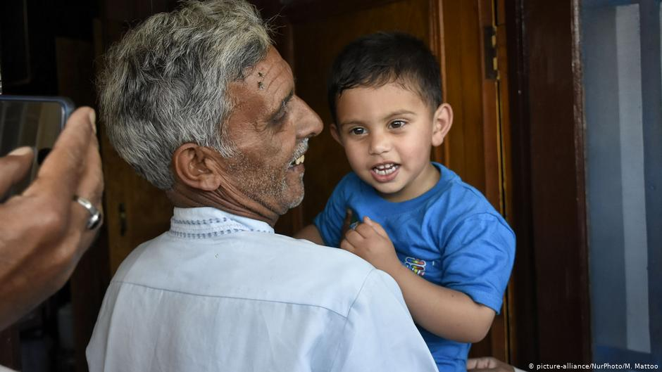 bashir ahmed with his 3 year old grandson days before he was killed by Indian forces in front of his grandson
