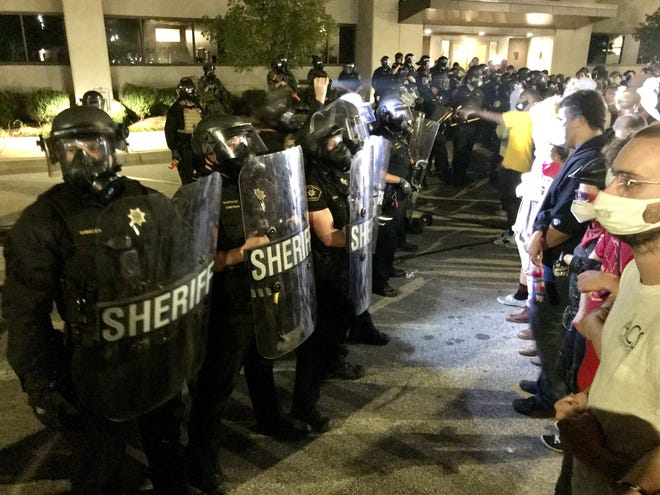 """Kenosha police in Wisconsin, US shot a black man multiple times in the back. The video showing the close-range shooting has surfaced on the web, sending unrest in the city. Jacob Blake, another Black victim to police brutality, is in a serious condition in Froedtert Hospital. The Incident Report Police had been called in the area of 2800 block of 40th street at 5:11 pm because of a domestic incident. This is where the shooting occurred later in the day. According to the key eyewitnesses, Blake was trying to break a fight between two women when he was tased and shot multiple times in the back. Immediate attention was provided to the victim and he was immediately carried off to the hospital as well. The officers involved in the shooting have been placed on administrative leave. Video On Social Media The video has also surfaced on social media where you see a black man in a white shirt and black shorts walking to a gray van with the police officers at the back. Their weapons are drawn, and the video does not show if there was any conversation or what happened before the man walked away from these officers. When the man opens the door to get in the van, an officer grabs his shirt to hold him still. This is when he shoots him in the back at close range. Almost seven shots can be heard along with a car horn, which was probably due to the man's head falling forward. A woman who followed the police can be heard screaming and jumping up and down. What Happened After That? Soon after the incident, Wisconsin State Patrol and Kenosha County Sheriff were asked to the scene because of the police involvement. An incident report is expected in the next 30 days, as promised by the investigating officers. Civil rights attorney Benjamin Crump shared the video on his Twitter account and wrote that Blake's three sons were in the car when he was shot right in front of their eyes for doing nothing: """"They saw a cop shoot their father,"""" Crump tweeted. """"They will be traumatized forever. We c"""