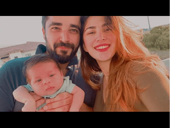 """Hamza and Naimal - the most popular and the heavenly gorgeous couple of industry is celebrating the 1st wedding anniversary. The couple has taken this celebration to Instagram while sharing family picture for the very first time. Hamza and Naimal Share Family Picture on WeddingAnniversary For the very first time, Hamza Ali Abbasi and Naimal Khawar shared family picture with Mustafa on social media. These adorable pictures are going viral as the fans have got chance to see the latest picture of Mustafa with parents. Hamza Ali Abbasi share this picture with the heartwarming caption to rejoice first wedding anniversary. He wrote with the picture: """"And one of his signs is that he created for you spouses from among yourselves so that you may take comfort in them and he placed between you Love & Mercy. In this there is surely evidence of Truth for those who ponder."""" Quran 30:21. 1st Anniversary ❤ Thank You Allah! On the other hand, Naimal Khawar also expressed gratitude towards all the blessings on her first anniversary. She also shared a family picture and wrote, """"Couldn't be more grateful to Allah🙏🏻 Anniversary ♥️"""" Hamza and Naimal's Wedding Hamza Ali Abbasi and Naimal Khawar got married last year on 25th of August. The couple announced the news without any sensational element and surprised fans. Everyone considered them a perfect couple and they looked magnificent on their wedding day. The ceremony was organized in a simple way with some friends and family invited to make it special moment. This wedding got popular for simple arrangements unlike other celebrity weddings. Hamza and Naimal Announced Arrival of Baby Boy Hamza Ali Abbasi and Naimal shared the great news of arrival of their baby boy on social media this year on 30th July. For the first glance of the baby and to share this news with fans, the picture was posted on 3rd August, 2020. This name of this cute baby of the gorgeous couple is Mustafa Abbasi. The couple expressed happiness and gratitude on welcoming """