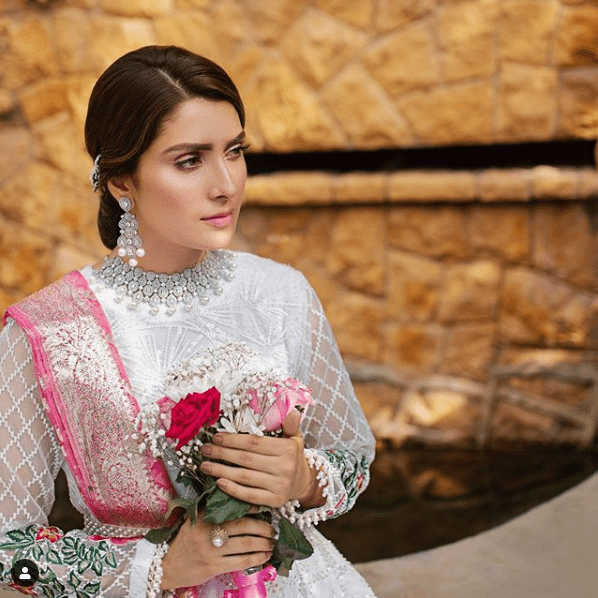 Ayeza Khan once again spreads colors around with her magnificent beauty and most amazing photo shoot. The way she carries herself is so dreamy and absolutely perfect that makes one keep staring. Although all of her photos have stunned the fans always but Ayeza Khan in her latest photos is looking traditionally rich so check out these clicks from her Instagram!  Ayeza in White & Floral Pink  This dress has been designed by Rj's Pret that introduced its Shadmani collection. This attire is treasured with all those breathtaking details & elegance that will create the magic for you. Each piece is handcrafted with love and perfection.  Ayeza Khan in Pastel Green  Taking summer season in accordance with the clothing color palette, Ayeza is dressed up traditionally in cool pastel green. This dress is also a classy presentation of Rj's Pret which is serene enough to make summer events go smooth. Have a look!  Fancy Divine Black and Ayeza Khan  Black is Ayeza Khan's color as it explores the aesthetics of her personality. The way she confidently carries it makes her have an outclass look. This dress is also fine artistic work by Rj's Pret exhibiting and endorsing the excellence of its collection by Ayeza. The balanced combo of divine black with gold makes this attire exquisite wear.  Ayeza in Gold & White Bridal Wear  RJ's Pret brings you another magnificently beautiful bridal wear from Shadmani collection which is designed up to perfection. The self-print unique clothing with delicate embellishment of jewels enhances the grace of bride. Ayeza Khan is looking stunning in this bridal wear and fans are loving it!  About Ayeza Khan  A very few people know that Ayeza's real name is Kinza Khan and she is known by her stage name Ayeza Khan. She was born on 15 January 1991.  Ayeza Khan has played the lead roles in several dramas including Zard Mausam, Adhoori Aurat, Mere Meherbaan, Do Qadam Door Thay, Pyarey Afzal, Tum Kon Piya, Mohabbat Tumse Nafrat Hai, Koi Chand Rakh, Yaariyan.  S