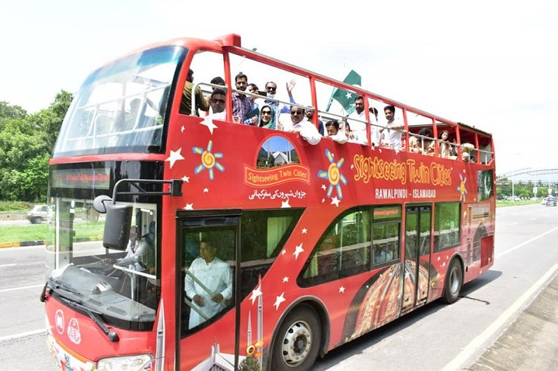 Double Decker Bus - The Punjab Chief Minister Sardar Usman Buzdar on Tuesday launched the Double Decker Bus Service in Rawalpindi. The Double Decker Bus Service will ply between Rawalpindi and Islamabad. While addressing the Launching Ceremony, Usman Buzdar expressed the commitment to transform the Punjab province into a tourism hub. The Chief Minister pointed out that there is a great potential of tourism in the province which will be exploited. He said that a project is on the cards to exploit the tourism potential of Kotli Sattian. Similarly, tourism will be promoted in the Potohar region including Jhelum and Chakwal. Referring to the Double Decker Bus Service, the Chief Minister said that it will facilitate the people to visit the tourist spots both in Islamabad and Rawalpindi. He said that the service will also be started in Bahawalpur. The Punjab Chief Minister said that the development projects of Rawalpindi are very close to his heart and the people will soon hear good news regarding Ring Road project and Nullah Leh Expressway. Usman Buzdar said that the development of backward areas is the priority of the government. He said that 33 percent funds have been allocated for South Punjab where a separate Secretariat has also been made functional. Later answering the queries of media persons, the Punjab Chief Minister said that the government will soon launch the Safe City Project in Rawalpindi to ensure the security of the city. Sardar Usman Buzdar said that the provincial government will soon initiate work on the ring road project to resolve the traffic problems in the City besides the expansion of Ammar chowk, Kohsar University Murree, Institute of Urology Rawalpindi.