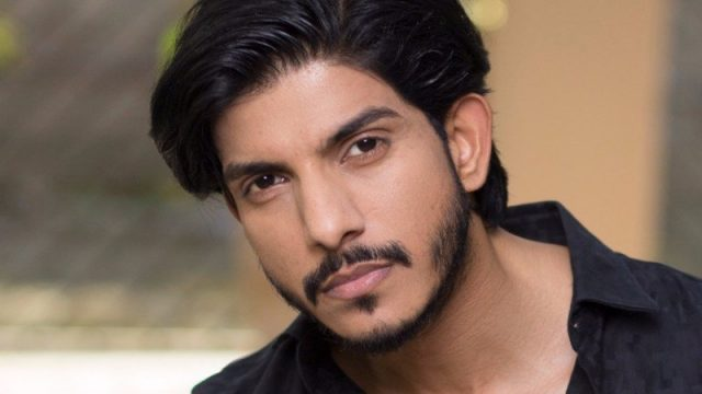 """Mohsin Abbas is a Pakistani actor, singer, and writer. He is well known for his appearance in Dunya news as DJ. He was married to Fatima Sohail before they both got divorced. Abbas also appeared in some films including Na Maloom Afraad, he was also featured in Coke Studio season 9 and sung Uddi Ja which was written and composed by himself. He won best Singer of the year award for this song in Lux Style Awards 2019. By the end of April 2018, he performed more than 1.500 songs in different genres. Anyway, despite his fame as DJ, singer, actor, and writer he also famous for controversies. Recently the FIA (Federal Investigation Agency) Cybercrime Wing, arrested him along his girlfriend Nazish Jahangir. They were found guilty of blackmailing, harassment, fake pictures, and videos. Before this event, Mohsin Abbas's ex-wife has already filed a complaint against him and his girlfriend that they both used to harass her over social media and there was also a lot of controversy about him has his ex-wife, she claimed that he used to beat her and before the divorce accused him of extra-marital affair with model Nazish Jahangir. However, after this event she thanked FIA for arresting him. In her Instagram post she wrote, """"Finally after a long legal battle against the injustice to me and my son FIA has found Mohsin and model Nazish guilty of the crime, fake videos and fake posts against me being circulating and harassing me on social media,"""" She further added that, """"I kept quiet for a long time as the case is being processed in court and today FIA interrogated regarding the matter, I am hopeful to get justice very soon, I request you all to remember me in your prayers. And they were arrested from their apartment in Karachi""""."""
