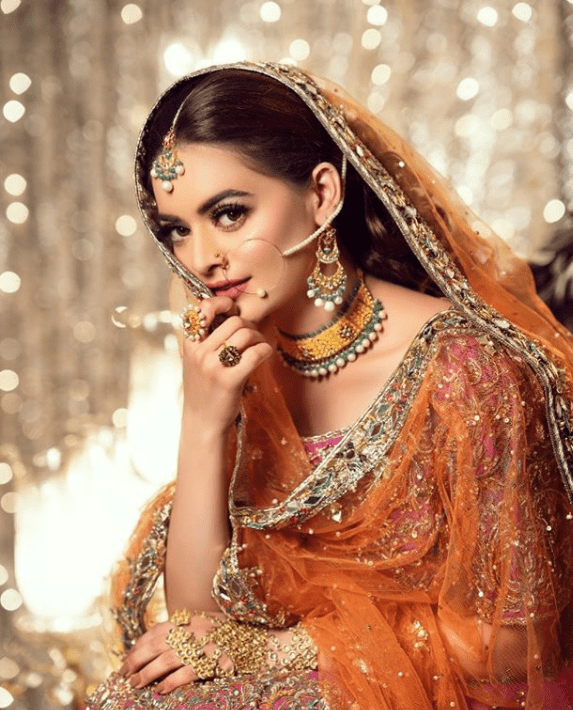 Minal Khan is back to work after her much-needed post-Corona pandemic vacation, and she is absolutely as breathtaking as we expected her to be. The actress is known for her photoshoots because she definitely aces them and this time around is no exception. In her latest photoshoot for a salon, she dons the look of a bride, and oh my my! she definitely steals the show. Minal Khan's Latest Photoshoot Minal has recently done a bridal campaign for a salon called Makeovers by Amaima. The campaign is targeted toward the bridal trend of the remaining season, 2020-2021. One look for the shoot has been released and Khan looks every bit gorgeous and breathtaking as a bride. She shared the look of her photo shoot on her official Instagram account too. Here is what she posted: Who Was The Shoot For? As mentioned, the shoot was done for Makeovers by Amaima Salon. The dress was by Samsara Couture, Jewels by Grace Jewelers, and Photography by Bilal Saeed Photography. The makeup artist shared multiple pictures of the shoot on her account including a huge tiled version of the pretty actress. Here are the pictures: Minal Khan is definitely the rising young talent of the industry we all look up to. From her drama projects to the Instagram influencer, modeling gigs to advertisement, she is going to the top with speed and she absolutely deserves it too. Do let us know how you liked the shoot in the comments section.