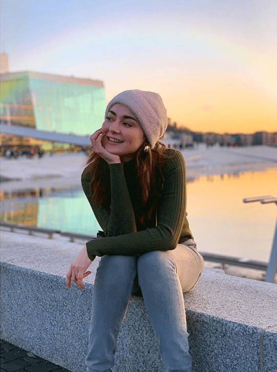 Hania Amir is one of the most Insta-popular actresses of Pakistan. There is no shock in that since it was her Instagram that ensured she get an entry into the industry of Pakistan, and that's how she became an actress. We are not complaining, because she deserves every bit of the success she has now. Having said that, her Instagram profile is still the best place to get the peak of her lively personality. This is why we have decided to do a round-up of our ten favorite pictures from Hania Amir's Instagram account: The Dreamy Hania Amir! This picture was posted right after the entire drama that pursued her and Asim Azhar's alleged breakup. There was a long commentary on the post, but this dreamy picture of the hyper-active Hania was definitely perfect to go with it. Chic & Cute! Cute is the signature word for Hania. She looks equal level chic and equal level cute in this picture. Porcelain Doll We won't be lying if we see, she definitely looks like a porcelain doll here! That Full Laugh! If you have been following Hania on her Instagram lately, you will know this full laugh is the signature of all her stories, videos, and YouTube vlogs. And truth be told, her fans live for it! The Sari Though! We seldom get to see the Eastern side of her, but Hania makes sure when she does dress Eastern, she causes people to turn heads. What a pretty picture! The Birthday Girl! She celebrated her 23rd with style, and this picture is a testament to that. Cake, pretty flowers, and a huge smile on the face, what else do you want on your birthday? Fierce Yet Funny! Titled the same, she looks fierce in this tanned Eastern look. One of our most favorites so far. Love the look! Sunshine! The lime green dress, green fields, and the clear blue sky in the background with those sun rays add a complete mood to the picture! The Bridal Dream She turns heads every time she dresses up in a bridal dress. Love how petite and gorgeous she looks in this picture. Peaceful In Blue The peace and light surr