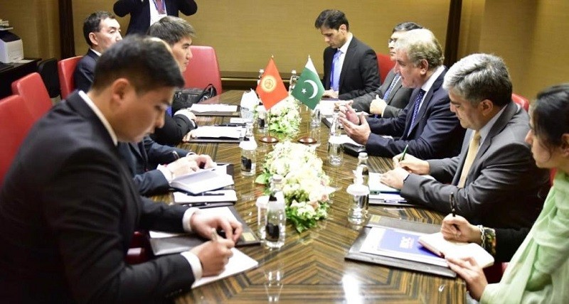 Pakistan-Kyrgyzstan trade- Pakistan and Kyrgyzstan have agreed on the need to increase mutual trade and comprehensively upgrade bilateral cooperation in all fields. The understanding was reached in a meeting between the Foreign Minister Shah Mahmood Qureshi and his Kyrgyz Counterpart Chingiz Azamatovich Aidarbekov held on the sidelines of Shanghai Cooperation Organization (SCO) Council of Foreign Ministers meeting in Moscow on Thursday.  During the meeting, both sides reviewed Pakistan-Kyrgyzstan bilateral ties and examined the prospects of cooperation in diverse areas including political, economic, regional connectivity and people to people contacts. The two foreign ministers agreed that it was important to enhance land and air connectivity.  Issues related to the welfare of Pakistani students and expatriate community were also discussed.  Both sides expressed satisfaction at their ongoing collaboration at the regional and international fora. The Foreign Minister Shah Mahmood Qureshi apprised his Kyrgyz Counterpart of the steps being taken by the Government of Pakistan to save lives and secure livelihoods in the wake of the COVID-19 pandemic. The foreign minister briefed his Kyrgyz Counterpart about evolving peace and security situation in the region.  Shah Mahmood Qureshi also briefed the Kyrgyz side on Pakistan's efforts aimed at promoting peace and stability in Afghanistan, Pakistan-India relations and human rights violations in the Indian Illegally Occupied Jammu and Kashmir (IIOJK). The two foreign ministers agreed to remain in close contact to further strengthen joint efforts for enhanced cooperation in all spheres of common interest.
