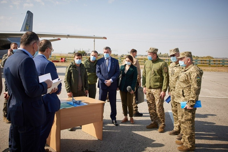 """An-26 aircraft - The Ukrainian President Volodymyr Zelensky visited the Country's northeastern Kharkiv region on Saturday to honor the memory of the victims of plane crash. On Friday night, An-26 aircraft with 20 Cadets and seven Officers from the Kharkiv Air Force University on board crashed in Kharkiv region, resulting in deaths of 26 people. """"Mourning has been announced over the tragedy that occurred yesterday in the Kharkiv region. Four takeoffs and, unfortunately, three landings. Tragic statistics, which, unfortunately, led to the death of both cadets and crew,"""" President Volodymyr Zelensky said according to his Office. President Volodymyr Zelenskyy noted that the crash killed young men from the 2nd to the 4th year of study and members of the plane's crew. In the crash, only two people onboard the ill-fated aircraft had survived but received serious wounds. However, later one of them died. """"We had information that two boys survived. One - of medium severity. The second - doctors fought for him, but, unfortunately, in the morning we were told that he had died. My condolences to family and friends,"""" Volodymyr Zelensky said. Immediately after the tragedy, the president held talks with Prime Minister Denys Shmyhal for the formation of a Commission to investigate the plane crash. The Commission included Representatives of the Ministry of Defense, the Ministry of Internal Affairs, the Prosecutor General's Office, and the State Bureau of Investigation. President Volodymyr Zelenskyy wants to receive information from relevant experts on the composition and technical condition of all military equipment in service in Ukraine. """"We want to see complete statistics of all our equipment,"""" the president said. Meanwhile, President of the Republic of Poland Andrzej Duda, Prime Minister of Canada Justin Trudeau, High Representative of the European Union for Foreign Affairs and Security Policy Josep Borrell, the Foreign Ministers of Poland, Albania, Bulgaria, Turkey, Sweden, Latvia"""