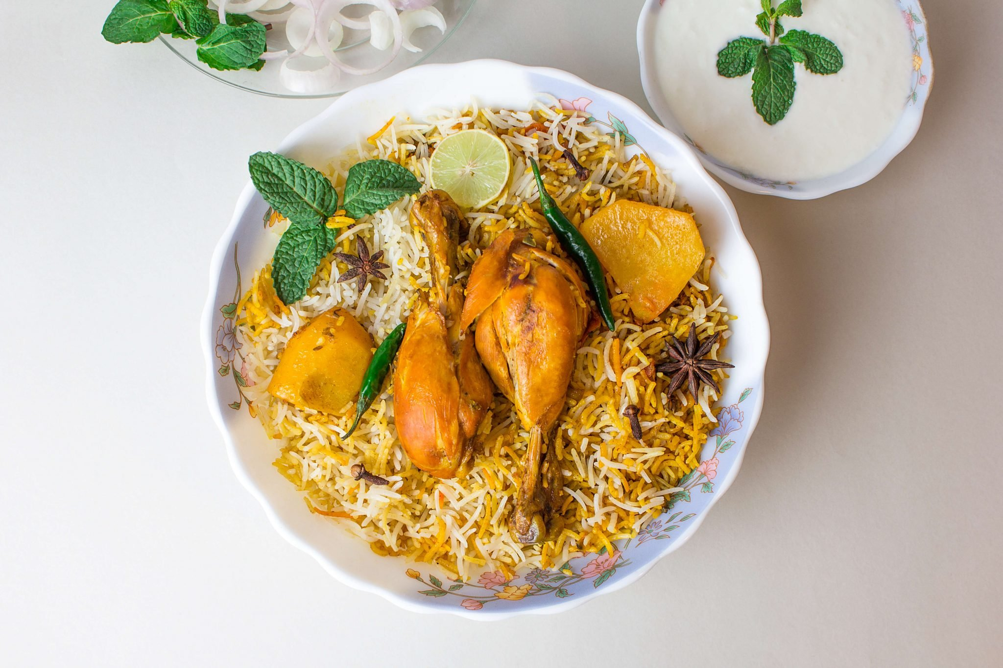 Biryani is the traditional dish of the Subcontinent that is famous all over the world. The tempting aroma and the creative blend of masalas with chicken or beef make it a whole feast. Although there are so many types of Biryanis, however, Hyderabadi Biryani is considered one of the richest forms. People love to have it with their friends and family as it brings them all of them at one table. There are different recipes that have been used for Hyderabadi biryani, however, this recipe is a traditional one and rich in taste. Check out the details! How To Make Best In Taste Hyderabadi Biryani? Check out the ingredients and recipe here for the best in taste Hyderabadi biryani that will be on you unforgettable list. It is simple and perfect to make at home. Note down these details! Ingredients In order to achieve the best results, follow each step and use all the mentioned ingredients. This recipe has been in use for many years and produces a welcoming aroma with perfect taste. It is also called Kacchi Hyderabadi Biryani as it has rice used in the partially cooked form and finally prepared in dum style. So, note down these ingredients now. Main Ingredients 1 Kg meat 1 tbsp salt 1 tbsp ginger garlic paste 1 tbsp red chilli paste 1 tbsp green chilli paste (sauteed brown onions to taste) 1/2 tbsp cardamom powder 3-4 Cinnamon sticks 1 tbsp cumin seeds 4 Cloves A pinch of mace to taste mint leaves 2 tbsp lemon juice 250 gms yogurt 4 tbsp clarified butter 750 gms semi-cooked rice 1 tsp saffron 1/2 cup water 1/2 cup oil Garnish ingredients Eggs, boiled Carrots, sliced Cucumbers Recipe So, gathering all of these ingredients, now you have to follow these steps for making the richest in flavours Hyderabadi Biryani. Step 1 Wash and clean the meat properly. Step 2 Now add yogurt, salt, red chillies powder, ginger garlic paste, green chilli paste, sauteed brown onions, cardamom powder, cinnamon, cumin seeds, cloves, mace, mint leaves and lemon juice in the meat to marinate. Step 3 Mix