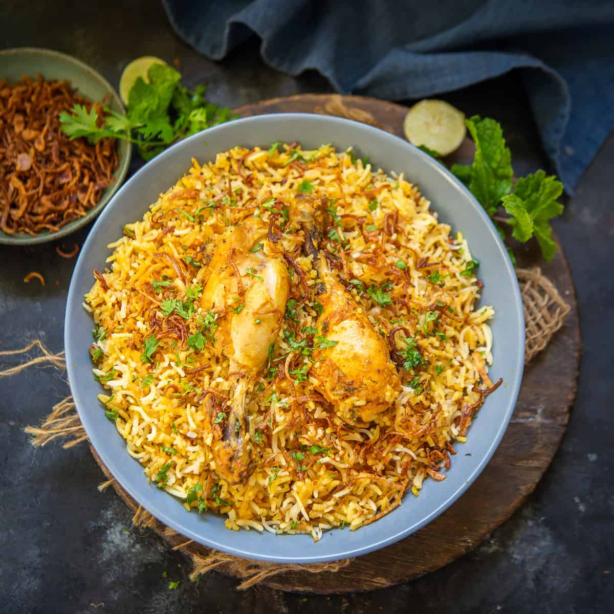 Thinking of something most relishing to eat will give you an idea to have spicy biryani. However, the best thing would be if you can make it at home. You must be looking for the recipe of biryani and we have got the most appropriate one. But wait! Before that, we would like to ask, do you know, from where biryani emerged as one of the most fascinating dishes in the subcontinent? Here we have got some interesting info related to the history of biryani. Check out these details! History of Biryani Biryani is a mixed rice dish with its origins among the Muslims of the Subcontinent. It is made with spices, rice, and meat (chicken, beef, mutton), and sometimes, in addition, eggs and/or potatoes in certain regional varieties. Biryani is popular throughout the Subcontinent, as well as among its diaspora. It is also prepared in other regions such as parts of Afghanistan, Iran and Iraq. Biryani is a dish that has acquired a niche for itself in South Asian cuisine. Biryani is an Indo-Aryan word derived from the Persian language. The exact origin of the dish is uncertain. However, in North India, different varieties of biryani developed in the Muslim centres of Delhi, Lucknow, and other small principalities. In South India, rice is more widely used as a staple food. So, several distinct varieties of biryani emerged from Hyderabad Deccan as well as Tamil Nadu, Kerala, Andhra Pradesh, and Karnataka, where Muslim communities were present. Different Types of Biryani Biryani is made with different variations and each of its forms are scrumptiously delicious. Here we have got a review of various spicy versions of mouthwatering biryani from the Subcontinent. Hyderabadi Biryani Hyderabadi Biryani has come straight from the streets of the Hyderabad city with authentic flavours. It is one of the most popular forms of biryani presenting a range of aromatic spicy flavors. Hyderabadi Biryani is half-boiled rice layered with fried onions, mint, cooked meat, and cooked dum style. Qeema Biryan