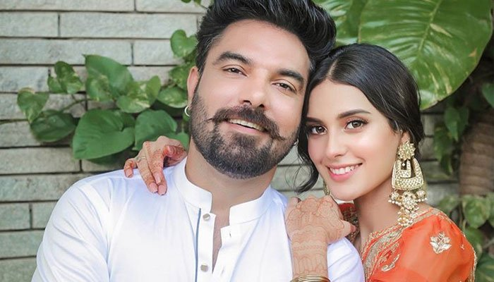 """It's Iqra Aziz's birthday! So, husband Yasir Hussain has made it special by sharing a heartwarming wish on Instagram. This lovely wish took away Iqra's heart and that of the fans as well. Iqra and Yasir are lovebirds who have always remained in the limelight for their relationship before and after marriage. They share the best moments together and their love is growing with every passing day. The couple keeps on posting adorable clicks from everyday life depicting their happiness in having each other. Now, Yasir has posted a lovely wish on Insta with a beautiful click that we couldn't resist sharing with you all! Iqra Aziz's Birthday & Yasir Hussain's Wish! Check out how Yasir wished his wife Iqra on her big day by a selection of lovely words in the Urdu language. First, let's have a look at this adorable click of the couple posted by Yasir! And... here we have the heartwarming birthday wish note written by Yasir Hussain along with this picture! سالگراہ مبارک ہو اقرا عزیز حسین ۔ اللہ کرے جتنی خوش تم اس سال ہو ہمیشہ رہو ۔ آمین آئی لو یو ❤️ ٹو دا 🌖 مون اینڈ بیک اور اُس سے بھی آگے کیونکہ ستاروں سے آگے جہاں اور بھی ہیں ابھی عشق کے امتحاں اور بھی ہیں He wrote: """"HAPPY BIRTHDAY IQRA AZIZ HUSSAIN. I PRAY TO ALLAH THAT YOU ALWAYS STAY HAPPY THE SAME WAY YOU ARE HAPPY THIS YEAR. AMEEN. I LOVE YOU TO THE MOON AND BACK AND EVEN BEYOND THAT."""" Here is How Iqra Responded To This Beautiful Wish! Here we have got the comment of Iqra Aziz for the way she responded to her husband's wish. She said: """"SHAADI K IS EK SAAL MAIN APNAY JITNA KHUSH MUJHE RAKHA HAI AB AGAY ZINDAGI AUR BHI HASEEN HOGI INSHALLAH♥️ I LOVE YOU TOO MY LIFELINE🌸♥️😘 ALLAH HUMAIN AESA HI RAKHAY, AMEEN🤲🏻💖"""" We wish our beloved Iqra a very happy birthday and best wishes for the future. To all the fans, as it is Iqra Aziz's birthday, what do you want to say about this talented actress? Share your valuable feedback with us!"""