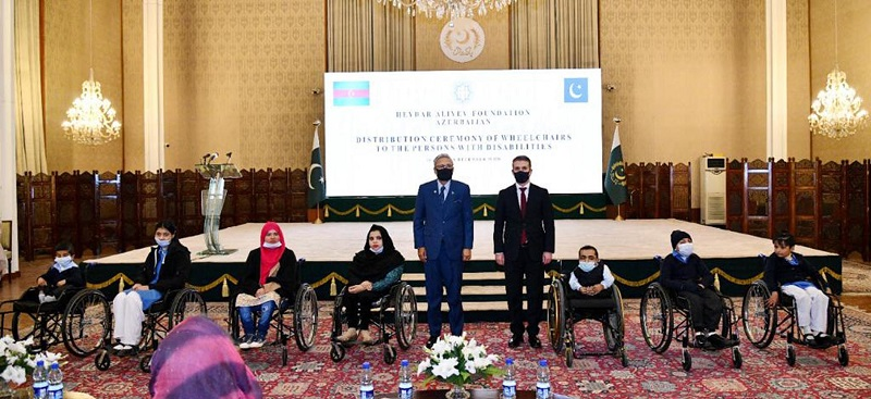 """Disabled people - The Embassy of Azerbaijan in Islamabad has gifted 100 customized wheelchairs to the disabled people in Pakistan at an event held at Aiwan-e-Sadr in Islamabad on Tuesday. The event was attended by President Dr Arif Alvi, First Lady Samina Alvi, Azerbaijan's Ambassador Ali Alizada and a number of disabled persons including children. In his address at a Wheelchair Distribution Ceremony, the president said that persons in the society deserved access to education and employment as their """"equitable right, and not as charity"""". """"The State is responsible to transform the society in a way that it accepts and mainstreams the differently-abled persons in all segments of life,"""" the president said. President Arif Alvi emphasized on adopting inclusive approach towards persons with disabilities by providing them education at regular schools instead of secluding them at special institutes. The president said that persons with physical, visual or hearing impairment could be easily absorbed into the normal school system, to be followed by targeted skilled training for their accommodation at workplace. """"It is the time to shun the stereotype approach towards disabled persons and give them opportunities and access to facilities,"""" he said. Dr. Arif Alvi stressed proper implementation of 2.5 percent disabled quota in jobs and ensuring training through the National Vocational and Technical Training Commission (NAVTTC) and the Technical Education and Vocational Training Authority (TEVTA) for effective results. The president mentioned that of the social welfare agenda initiated by him and his wife, the uplift of disabled people was a priority and 'a subject close to their hearts'. President Arif Alvi said that the government under the Ehsaas project had registered two million people with disabilities for disbursement of stipend while banks had also launched schemes to offer loans for special persons to carry out small and medium enterprises. The president mentioned that the """
