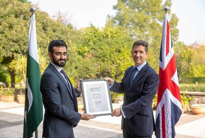 """Hamza Farrukh - Her Majesty Queen Elizabeth II has recognized Hamza Farrukh, representing Pakistan, as the 129th Commonwealth Point of Light in honour of his exceptional voluntary service providing clean water to local communities in Pakistan. The British High Commissioner Dr Christian Turner presented the award to Hamza Farrukh at a ceremony arranged by the British High Commission here on Tuesday. The Commonwealth Points of Light is a continuation of this programme with a special series of awards recognizing inspirational volunteers throughout the Commonwealth, coinciding with the UK being the Chair-in-Office of the Commonwealth for the next two years. One volunteer from each of the 53 Commonwealth countries was recognised in the days leading up to the Commonwealth Heads of Government Meeting in April 2018. Hamza Farrukh runs a charitable project 'Bondh-E-Shams' (droplets of sunshine) which is serving over 45,000 people across 13 remote Pakistani villages. Hamza began Bondh-E-Shams' as a college project in March 2014, focusing on one particular Pakistani village. He was then awarded further funding to set up the charity, which has now provided over 10 million cups of water to people in remote communities in Pakistan through an environmentally friendly, solar-powered water extraction and filtration system. Hamza Farrukh said: """"At Bondh-E-Shams, we have promised to take on the global water crisis: lack of access to safe water in large swaths of developing nations is symptomatic of the numerous structural disadvantages faced by the global south. My team and I realise the responsibility we have towards the 1.2 billion people who go to bed thirsty each night, and are dedicated to this lifelong fight."""" The British High Commissioner, Dr Christian Turner, said: """"I am delighted to present Hamza Farrukh with the Commonwealth Points of Light award for his exceptional voluntary service and ingenuity in helping to provide safe drinking water to tens of thousands of Pakistanis. """