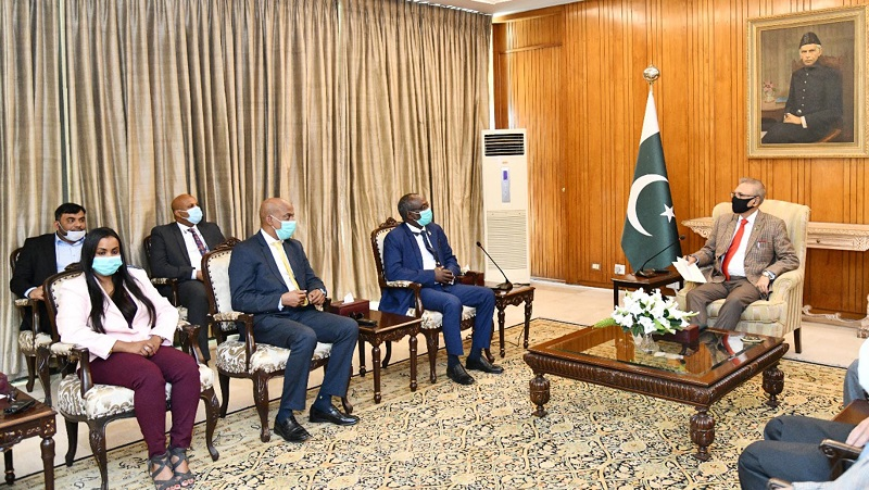 Pakistan-Djibouti cooperation - Pakistan and Djibouti have reiterated their desire to strengthen bilateral cooperation in the areas of commerce, culture, and defense. This was discussed at a meeting between President Dr. Arif Alvi and the visiting Djibouti Parliamentary delegation led by the President of the National Parliament of Djibouti and the acting-Chairman of African Union Parliament Mohamed Ali Houmed at Aiwan-e-Sadr in Islamabad on Wednesday. While welcoming the delegation, the president said that Pakistan and Djibouti enjoy excellent relations, and Pakistan wants to further improve defense and economic ties with Djibouti for the mutual benefit of the two brotherly Countries. The president appreciated the visit of the Parliamentary delegation and expressed the hope it would further strengthen the existing foundation of strong bilateral relations between the two Countries. President Arif Alvi informed that Pakistan highly values its ties with Djibouti and has decided to open its embassy there and resident diplomatic missions in other African Countries. Dr. Arif Alvi sought the support of the government of Djibouti to expeditiously process and clear Pakistani goods at Djibouti port meant for Ethiopia and other destinations in the Horn of Africa. Furthermore, the president also highlighted the atrocities and human rights violations being committed by India against the Muslim population in the Illegally Occupied Jammu and Kashmir (IIOJK). The president emphasized the need for a unified call from the international community to put pressure on India to stop human rights violations and grant Kashmiris their right to self-determination as promised under the UN Security Council resolutions. The President of the National Parliament of Djibouti underscored the need for expanding bilateral cooperation in every sphere, including culture, trade, and defense. President Arif Alvi said that Gwadar and Djibouti Ports would help boost trade between the two brotherly Countries