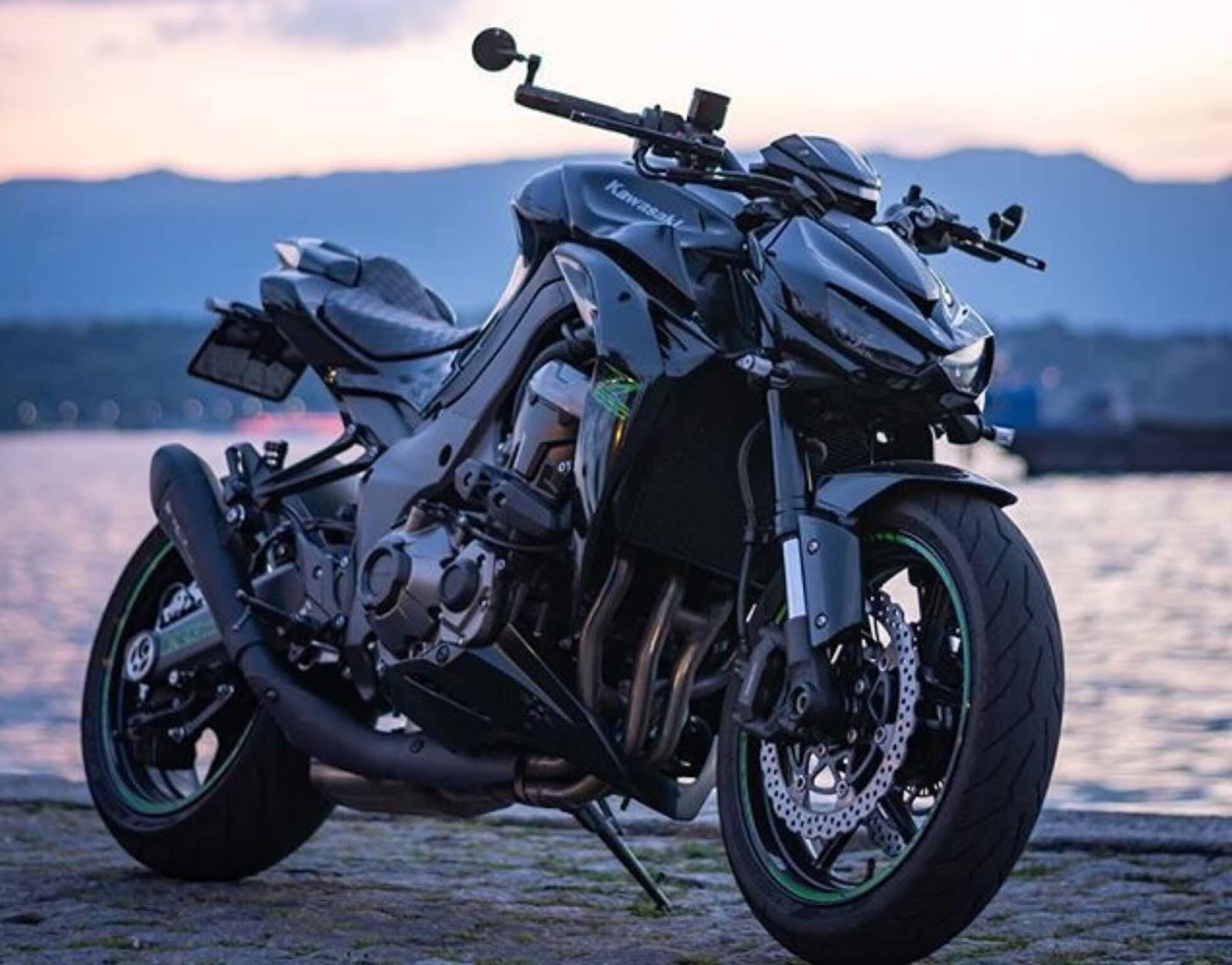 Kawasaki Z1000 2020 model bike has been finally launched. You might have dreamed of having such a classy bike with amazing features and now it's available in Pakistan. The bike is designed with a four-cylinder exclusive style that instantly grabs one's attention. Kawasaki Z1000 2020 was first introduced as a successor to the early-1970s and Z900 machines. However, the company redesigned it later for 2020. Along with its standard style, an updated version came up in a slightly larger capacity engine. Here we have got further details! Kawasaki Z1000 2020 - Specs and Price! Taking a look at the features and specs of this bike, Kawasaki Z1000 comes with 4-stroke, liquid-cooled, DOHC, four valves per cylinder, inline-four engine. The bike has its displacement as 1043cc. The new design makes front suspension adjustments easier, even while you're out on a ride. Stepless compression and rebound damping are adjusted on one fork leg, and spring preload is adjusted on the other. The rear suspension is handled by a horizontal back-link rear shock, which is adjustable for rebound damping and preload and is located away from the possibly performance-degrading exhaust heat. Now you can have this best version of Kawasaki Z1000 2020 bike at the reasonable price that can make your dream come true. The price of this bike in Pakistan is estimated to be at1,000,000-1,500,000 PKR and is available in used condition. More About Features, Specs of Kawasaki Z1000 2020 Here we have got some more of the information about the features and specs of the Kawasaki Z1000 2020 model: Engine Four-stroke, liquid-cooled, DOHC, Four valves per cylinder, inline-four Displacement 1,043cc Bore x Stroke 77.0 x 56.0mm Compression ratio 11.8:1 Fuel System DFI®with four 38mm Keihin throttle bodies, oval sub-throttles Ignition TCBI with digital advance Transmission Six-speed Final Drive Sealed chain Performance Front Suspension / Wheel Travel 41mm inverted SFF-BP fork with stepless compression and rebound dampin