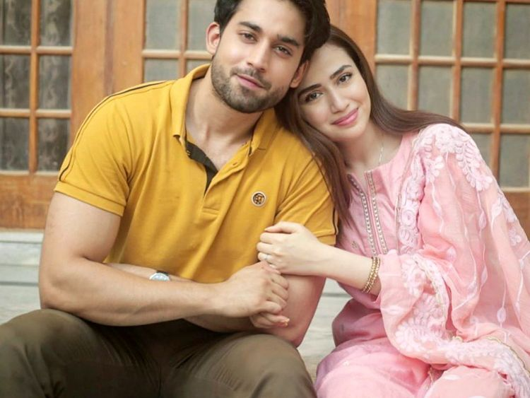 """The ever-gorgeous Sana Javed and super talented heartthrob Bilal Abbas is all set to grace our screens together with drama serial Dunk. The news of this upcoming drama has been spreading around on social media with some casual clicks of Sana and Bilal. It is one that most demanded couple people have always wished to see on the screen. As we know that Sana Javed and Bilal Abbas are amazingly talented actors, it will be the finest merger to bring them together in a drama. Here we have got some more details! Sana Javed and Bilal Abbas To Show Up In Dunk! Dunk is a drama serial that will be going on air at ARY Digital starring Sana Javed and Bilal Abbas Khan in the lead cast. The drama serial is a murder mystery just like that of Cheekh. Sana Javed is playing the lead role character """"Amal"""" and Bilal Abbas is playing the lead actor role as """"Haider"""". This is the first time Sana Javed and Bilal Abbas have paired up for a drama. Here we have got the three title looks of drama serial Dunk. Take a look!"""