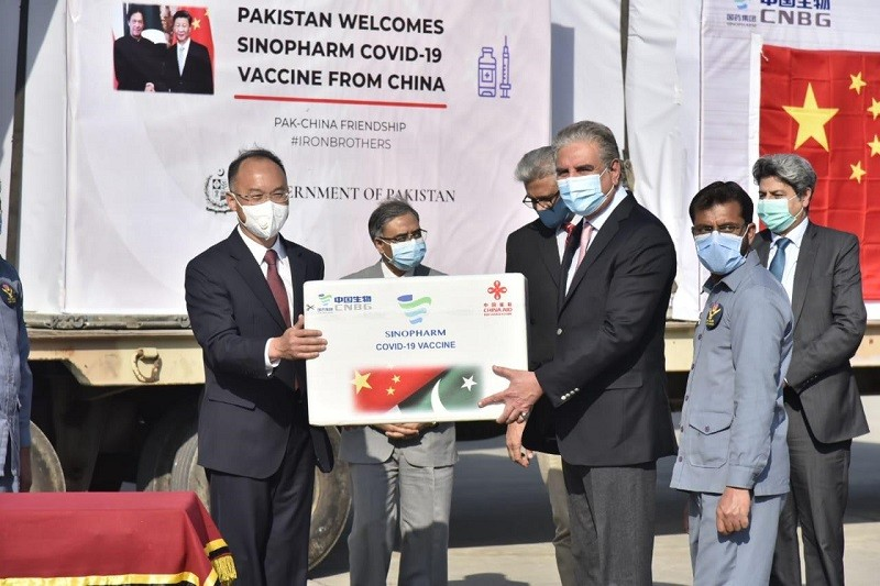 Sinopharm vaccine - The Foreign Minister Shah Mahmood Qureshi on Monday received a batch of 500,000 doses of Sinopharm vaccine from the Chinese Ambassador Nong Rong at a ceremony held at the Nur Khan Airbase in Rawalpindi. The vaccine arrived from Beijing early morning through a special flight. In his remarks on the occasion, the prime minister thanked the leadership and people of China for sending the gift of the Sinopharm vaccine to Pakistan to fight the COVID-19 pandemic. The foreign minister added that the vaccine had arrived right at the time when Pakistan was grappling with the second wave of COVID-19. Qureshi said that the vaccine's delivery, coinciding with the commencement of celebrations of the 70th anniversary of the establishment of diplomatic relations between Pakistan and China, reaffirmed the finest tradition that China always stood by Pakistan. It also showed that the Pakistan-China friendship was timeless and that China was our staunchest partner, he added. The foreign minister particularly lauded the Chinese President Xi Jinping's vision that the COVID-19 vaccine, when developed, should be a 'global public good.' Shah Mahmood Qureshi expressed special gratitude to the State Councilor and Foreign Minister Wang Yi for expeditiously sending the vaccine to Pakistan. The vaccine will be used to inoculate the front-line health workers to protect them from COVID-19 and will play an important role in saving precious human lives, he added. It was underlined by the foreign minister that recently Phase-III clinical trials of Chinese vaccine CanSino had successfully concluded in Pakistan and Pakistan was deepening co-operation with China in the matters relating to the vaccine. The Prime Minister's Special Assistant on Health Dr. Faisal Sultan, the Foreign Secretary Sohail Mahmood, the Secretary Health Aamir Ashraf Khawaja, and the Executive Director National Institute of Health (NIH) Major General Aamer Ikram were also present on the occasion. Pakistan-China c