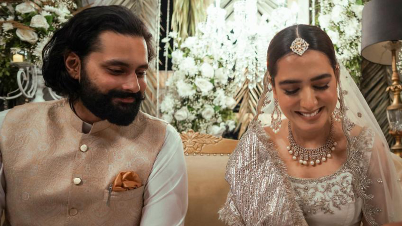The most elegant actress from the industry Mansha Pasha has finally tied the knot with Jibran Nasir in an intimate ceremony. Here we have got further details and the latest clicks from Nikkah. Mansha Pasha and Jibran Nasir Tie The Knot - Latest Clicks! Mansha Pasha got married to Jibran Nasir in an intimate ceremony in Karachi on Saturday. The actress took to the moment to Instagram and shared an adorable photo from their wedding ceremony. Her picture with a wedding ring has been circulating over social media. Here we have got the latest clicks from the event! Close friends and family attended the nikkah ceremony. Mansha and Jibran had announced their engagement back in 2019. As soon as these clicks made their way to social media, fans and fellow showbiz stars flooded the comment section with congratulatory messages. Jibran Nasir announced the wedding as: The ceremony was held at their house. Scholar Javed Ghamidi performed the couple's nikkah via video call. Mansha opted for a Zuria Dor ivory outfit while Jibran kept it simple and elegant with a white dress and a slightly fancy waistcoat. About Mansha Pasha Mansha Pasha is a Pakistani actress and television presenter. She is known for her supporting roles in several critically and commercially successful television series, including Shehr-e-Zaat, Madiha Maliha, Zindagi Gulzar Hai, Virasat and Mera Naam Yusuf Hai. She played Zoya in ARY Digital's comedy series Aangan. About Jibran Nasir Jibran Nasir is a passionate and energetic Pakistani Civil rights activist who is also struggling to hold a position in Politics. He is famous for his protests against terrorism in the country. Jibranwas born on 10 February 1987 in Karachi, Pakistan. He completed his A-Levels from The Lyceum School, Karachi and went to theUniversity of London for a Bachelor of Law (LLB). Later, he completed LLM from theUniversity of Northumbria.