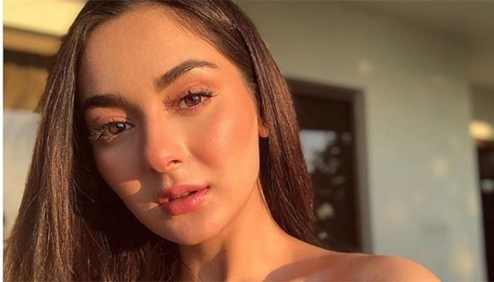 """We have been observing the trolling session going on social media that has engaged everyone with whatever is happening to Hania Aamir.  A few days ago, Pakistani actress Hania Amir was trending on social media as her video clip with Aashir Wajahat, son of the director, producer Shazia Wajahat and Wajahat Rauf, went viral.  The video clip turned the netizens furious and they started bashing Hania to the worst. In the wake of this troll series, it felt like Asim Azhar took an opportunity to post something relevant to Hania. Well, it started to cross commenting between Hania and Asim that further hooked the netizens.  Here we have got further details on what's latest on the matter!  Hania Aamir VS Asim Azhar - Here We Have Got Latest On The Matter!  Asim Azhar, who happened to be in a relationship with Hania Amir, tweeted a gif saying """"Baal Baal Bach Gaye"""" with the caption Alhamdulillah. It apparently looked like in a response to Hania Amir's viral video.  In response to this post, Hania commented in a separate social media post:  """"YOU CAN EITHER BE A CELEBRITY OR A BITTER EX WITH NO DIGNITY.""""  She captioned another detailed post referring to the recent online harassment incident against her.  """"SHOW SOME RESPONSIBILITY. BULLIES AND MISOGYNISTS ARE NOT WELCOME.""""  However, this match didn't meet the end even after this cross commenting. Asim Azhar again took to his Insta story that:  Here is Why Hania Got Upset?   Recently, during an Instagram live hosted by Hania, a part of the feed was trimmed and edited to include a picture of a man ejaculating onto her picture. That video was then uploaded online for thousands of people to see and share.  In the same series, she posted a video with Aashir on Insta that turned on the fire of criticism.  Watch this video!  After receiving extreme backlash, she deleted this video and posted another video in which we can see her upset and crying.  And the caption said:  """"JUST ANOTHER DAY SURVIVING IN A MISOGYNIST WORLD WHERE DOUBLE STAND"""